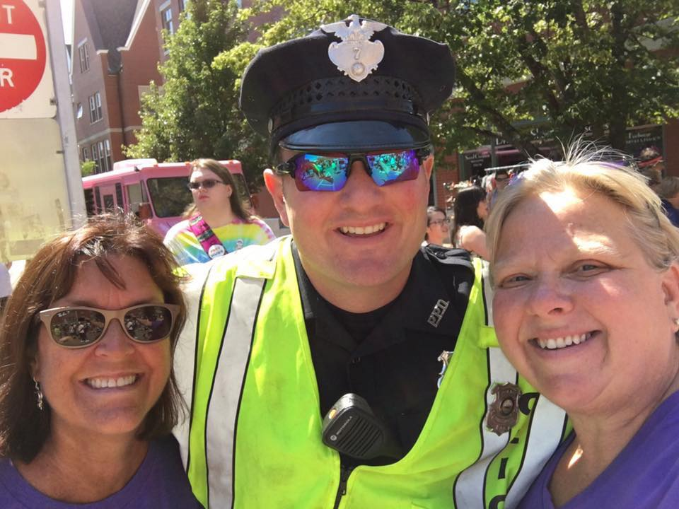 Police officer smiling with citizens