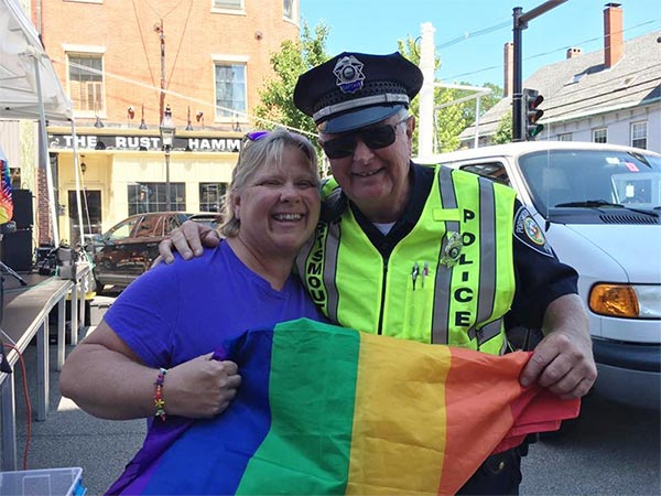 Auxiliary Police Officer with citizen during the Pride Parade