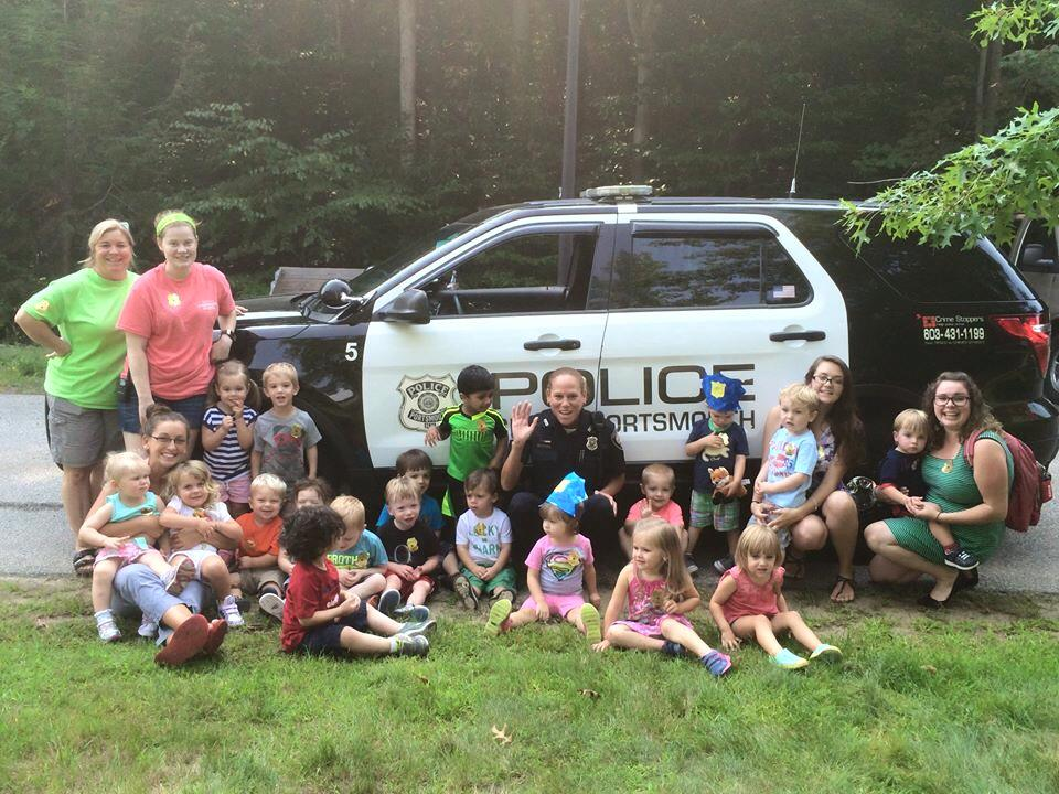 Lt. Rochelle Navelski with kids in front of a Police SUV