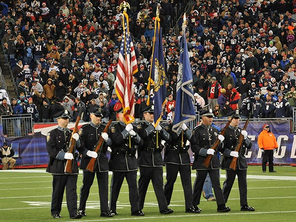Honor Guard presenting colors at a Patriots Game