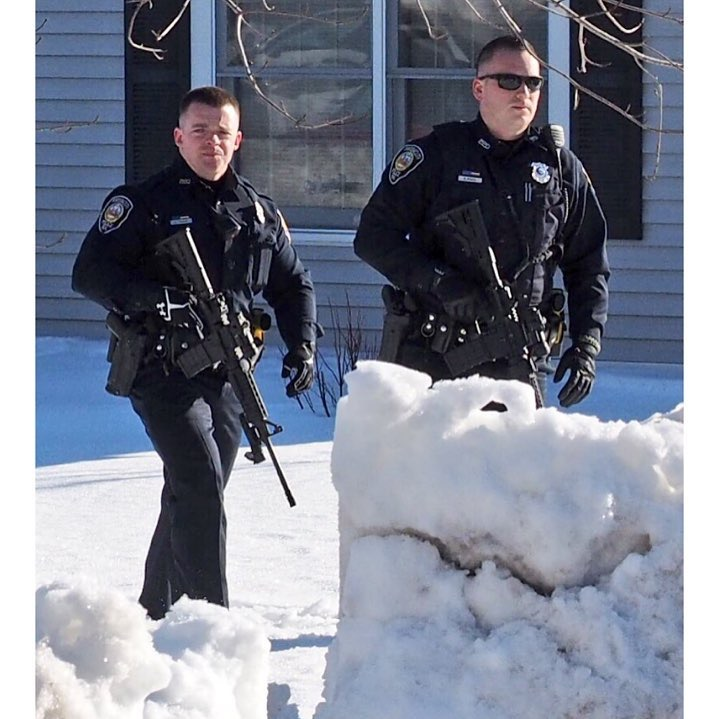 Police Officers walking through the snow