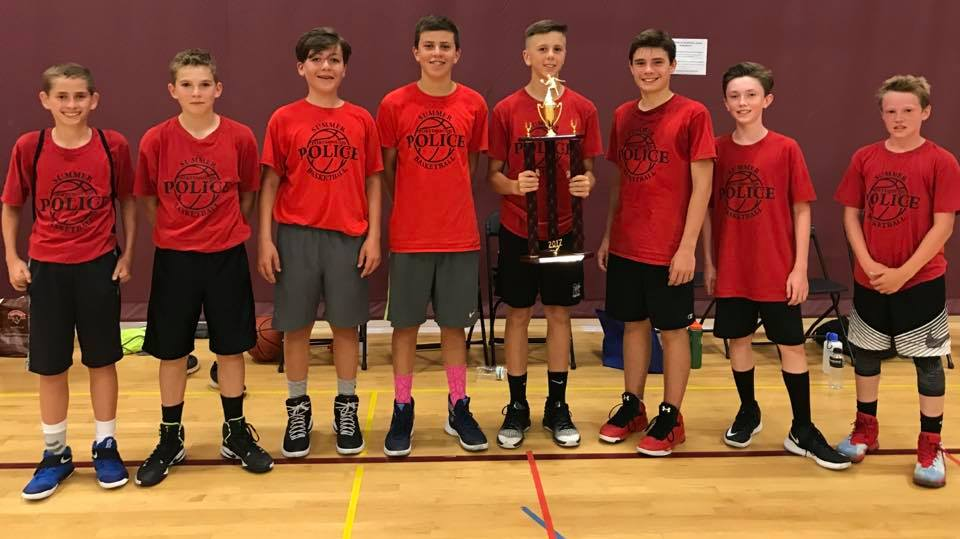 Summer Youth Basketball team with trophy