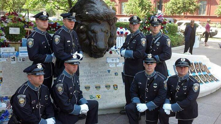 Honor Guard at memorial with lion head statue