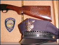 Police cap and rifle stock