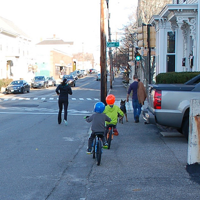 Kids riding their bikes on Islington Street