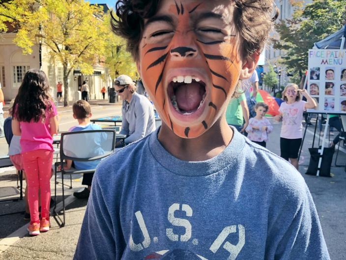 Boy in Market Square with tiger facepaint