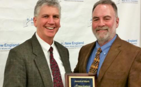 Brian Goetz receives his award from David Miller, President-Elect of NEWWA
